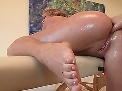 Dirty masseur fingering hot ass over his work table