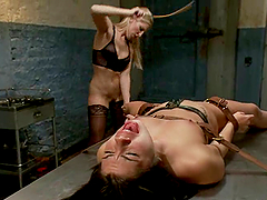 Tied up brunette babe gets toyed and tortured by two blondes