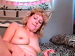 Mature woman masturbates and sucks a dick in a retro video