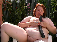 Big tits mature BBW spreading legs when masturbating