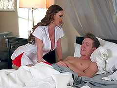 Busty nurse Nikki sucks and rides on her patient's thick member