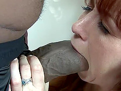 Saucy redhead has her tight anus destroyed with a monster black pole