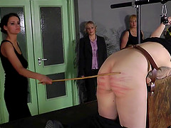 Lovely girl gets tied up before a mistress starts hitting her ass