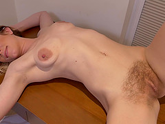 Ashleigh McKenzie takes off her dress and fingers her hairy pussy