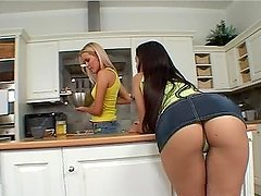 Eve Angel and Sophie Moone enjoy licking each other's vags in the kitchen