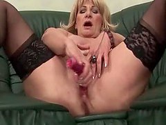 Nasty blonde mature shoving her panties in snatch