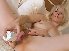 Mature blonde Hazel May moans sweetly while drilling her vag with a toy