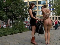 Tied up brunette walks naked in the street and gets laid