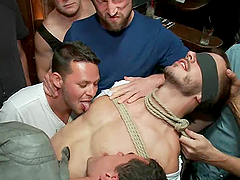 A tied up dude sucks big dicks and gets ass fucked