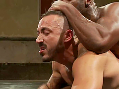Interracial gay sex with two muscled homos