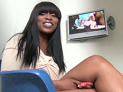 Ebony pornstar watching porno on the television backstage