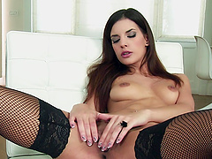 Candice Luca wears stockings and high heels as she masturbates