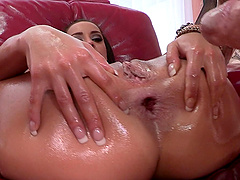 Oiled-up porn star with a great body enjoying a hardcore ass fuck