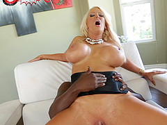Alura Jenson sucks and titfucks a black shaft before having anal sex