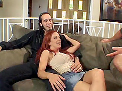 A redheaded MILF cuckolds her husband while getting some younger cock