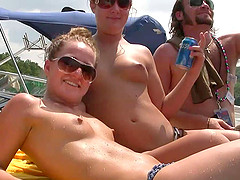 Randy chicks on the yacht party licking on natural tits