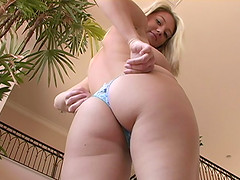 Pretty blonde Alison Angel tries on different pairs of panties