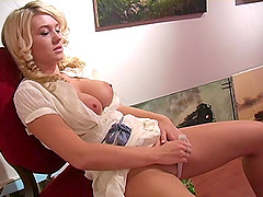 A hot blonde shows her great tits while playing with her pussy