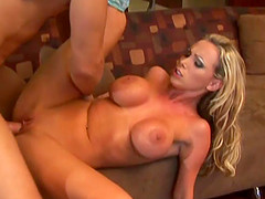 Hot blonde slut with a great body enjoying a hardcore fuck on her sofa