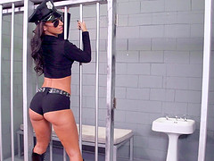 Oiled up police sluts use their prisoner in a hot jail threesome