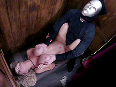 A creepy guy in a mask lays the pipe to a hot blonde