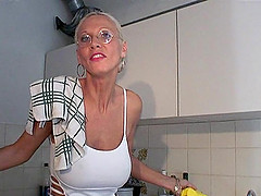 Tattooed granny with glasses sucking a stranger's cock