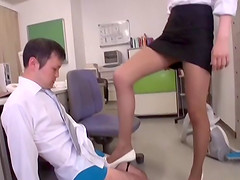 Kinky office slut gives a tremendous footjob to a co-worker