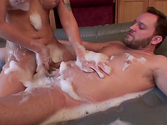Soapy wet body massage ends in a hot blowjob for her man