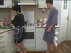 His maid is a horny old lady happy to fuck on his kitchen floor
