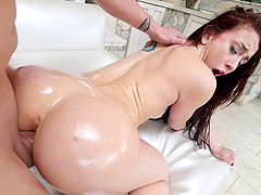 Slut in a swimsuit oils up her curves and gets fucked