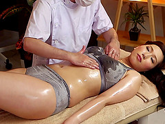 Hot Japanese milf on the massage table for finger fucking