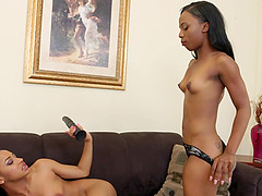 Ebony babe sharing their toys and tongues during a lesbian tryst