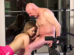 Cute girl and a fit grandpa fucking hardcore in the gym