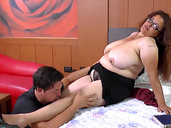 Chubby mature is fucking on bed