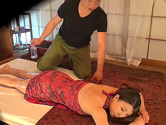 Every inch of her Asian body is covered in oil as they fuck