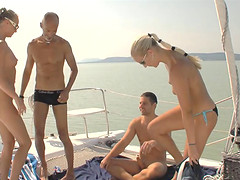 Muscular guys giving the sexy babes a good drilling on the boat