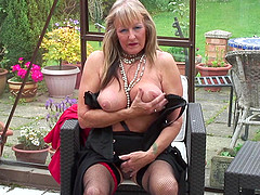 Brilliant matured granny stripteasing before masturbating outdoor
