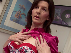Big natural tits mature dame moans when enjoying toys