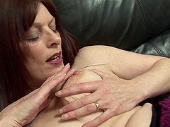 Redhead granny Sarah loves pleasuring her wet muff with a dildo