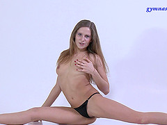 Long hair Flexible solo model pose displaying her natural tits