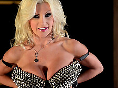 Blonde mistress Brittany Andrews bends over for a glass dildo