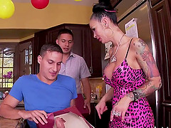 Busty Angelina Valentine treats a couple of men to her body