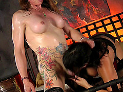 Ava Devine loves making a tattooed shemale's dick stiff
