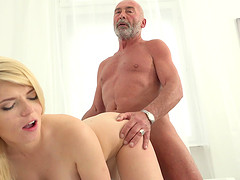 Sweet blonde Masha Ray bends over for a cock