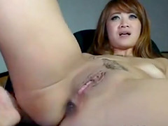 Horny asian babe on webcam fingering her both sexy tight holes and teasing