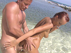 Claudia Adams seduced by a hunk for a fuck on a beach