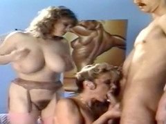 Beautiful girls with big tits get a deep throat threesome