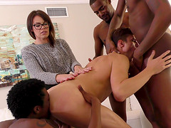 Nerdy chick and three black bods surround Alex Chandler to fuck him