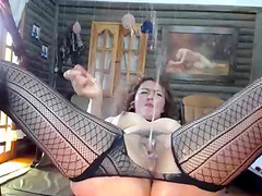 Magnificent Curly Milf Stuffs Her Kitty And Squirts On Camera