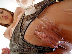 Oiled sweetie Gia Derza makes a monster cock disappear in her ass